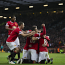Manchester United's Robin van Persie, lower centre, celebrates with teammates after scoring during the English Premier League soccer match between Manchester United and Liverpool at Old Trafford Stadium, Manchester, England, Sunday Dec. 14, 2014