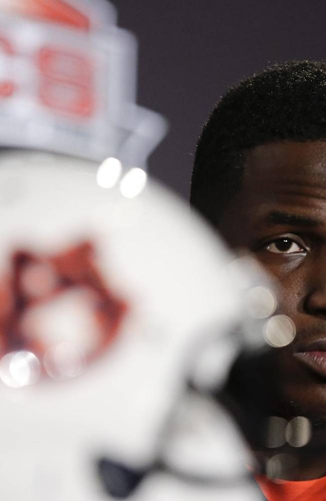 Auburn defensive back Robenson Therezie listens during a news conference Friday, Jan. 3, 2014 in Newport Beach, Calif. Auburn is scheduled to play Florida State on Monday, Jan. 6,  in the BCS national championship NCAA college football game