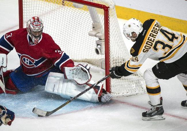 Montreal Canadiens goalie Carey Price makes a save off Boston Bruins' Carl Soderberg during the second period of Game 3 of an NHL hockey Stanley Cup playoff series, Tuesday, May 6, 2014, in Montreal