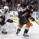 Anaheim Ducks right wing Devante Smith-Pelly (12) controls the puck in front of Chicago Blackhawks defenseman Johnny Oduya (27), of Sweden, during the second period of an NHL hockey game in Anaheim, Calif., Friday, Jan. 30, 2015 The Associated Press