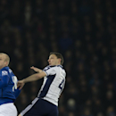 Everton's Steven Naismith, left, fights for the ball against West Bromwich Albion's Chris Baird during the English Premier League soccer match between Everton and West Bromwich Albion at Goodison Park Stadium, Liverpool, England, Monday Jan. 19, 2015