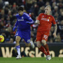 Chelsea's Diego Costa, left, fights for the ball with Liverpool's Martin Skrtel during the English League Cup semi-final first leg soccer match between Liverpool and Chelsea at Anfield Stadium, Liverpool, England, Tuesday Jan. 20, 2015