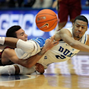 Duke's Quinn Cook (2) collides with Santa Clara's Evan Roquemore, left, while chasing a loose ball during the first half of an NCAA college basketball game in Durham, N.C., Saturday, Dec. 29, 2012.  (AP Photo/Ted Richardson)