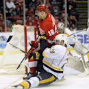 Detroit Red Wings center Joakim Andersson (18) knocks down Nashville Predators center Paul Gaustad (28) during the second period of an NHL hockey game in Detroit, Saturday, Jan. 17, 2015 The Associated Press