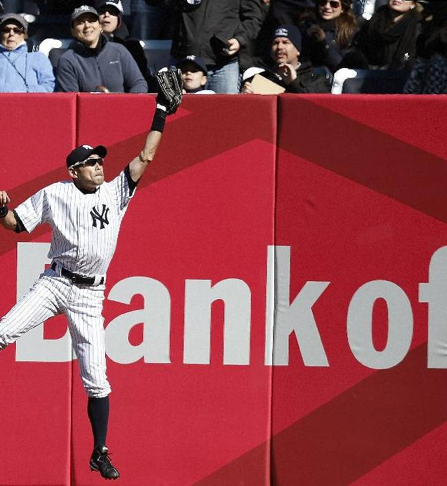 New York Yankees right fielder Ichiro Suzuki catches Ryan Sweeney's ninth-inning flyout for the second out in Game 1 of an interleague baseball doubleheader against the Chicago Cubs at Yankee Stadium in New York, Wednesday, April 16, 2014. The Yankees shutout the Cubs 3-0