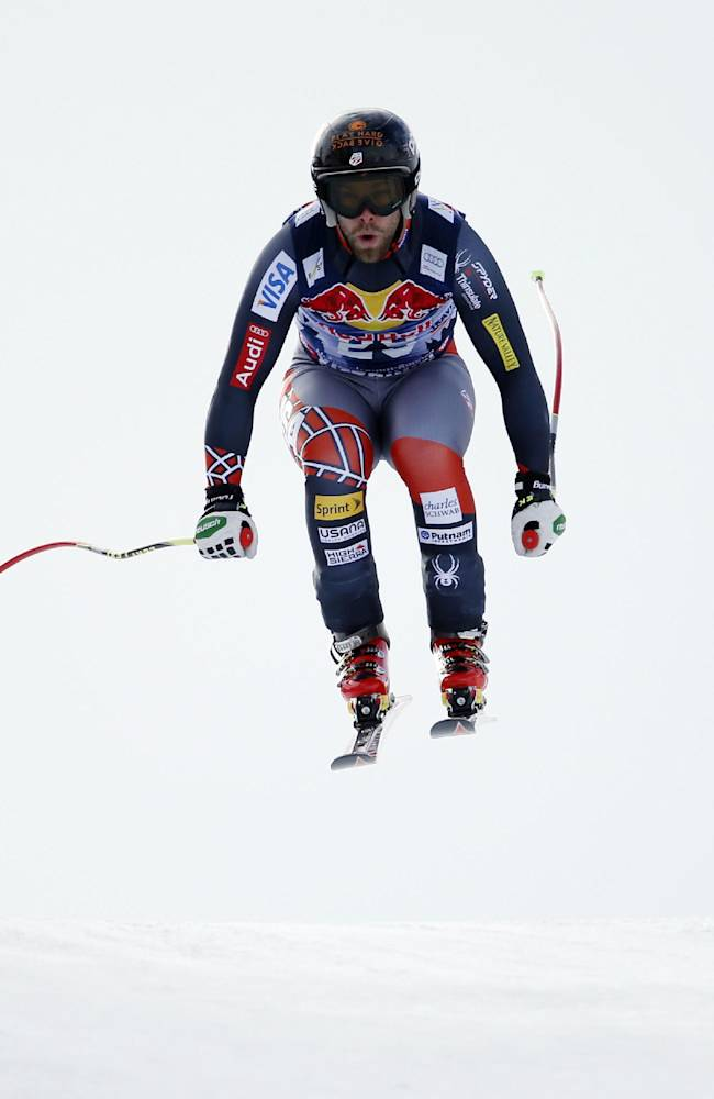 Travis Ganong, of the United States, speeds down the course during an alpine ski, men's World Cup downhill, in Kitzbuehel, Austria, Saturday, Jan. 25, 2014