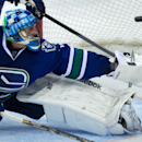 Vancouver Canucks' goalie Roberto Luongo allows the game-tying goal to San Jose Sharks' Tomas Hertl, of the Czech Republic, during third period NHL hockey action in Vancouver, British Columbia, on Thursday Nov. 14, 2013 The Associated Press