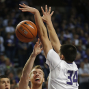 Kansas State forward Jack Karapetyan (34) blocks a shot by Pittsburg State Connor Kier (33) during the first half of an exhibition NCAA college basketball game in Manhattan, Kan., Friday, Nov. 1, 2013. Kansas State defeated Pittsburg State 75-54. (AP Photo/Orlin Wagner)