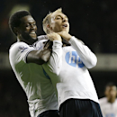 Tottenham's Christian Eriksen, right, celebrates scoring a goal with Emmanuel Adebayor during the English Premier League soccer match between Tottenham Hotspur and Sunderland at White Hart Lane stadium in London, Monday, April 7, 2014