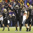 Washington's Sean Parker (1) celebrates after coming up with an interception against Oregon State in the first half of an NCAA college football game, Saturday, Oct. 27, 2012, in Seattle. (AP Photo/Ted S. Warren)
