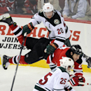 New Jersey Devils' Ryane Clowe (29) is checked by Minnesota Wild's Ryan Suter (20) during the third period of an NHL hockey game Thursday, March 20, 2014, in Newark, N.J. The Devils won 4-3 in overtime The Associated Press