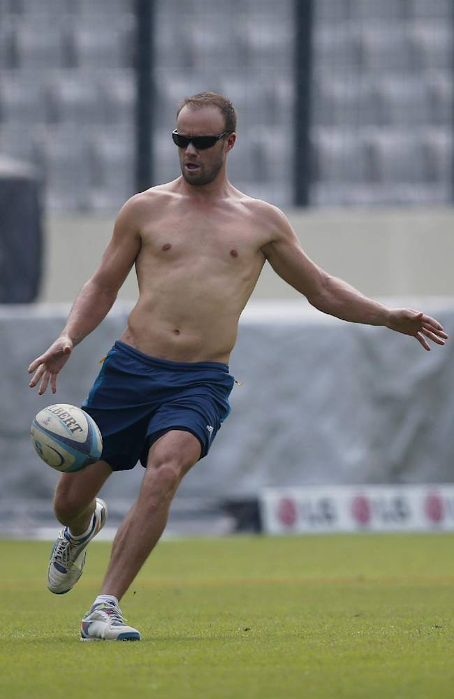 South Africa's AB de Villiers plays with a rugby ball during a training session ahead of their ICC Twenty20 Cricket World Cup semifinal match against India in Dhaka, Bangladesh, Wednesday, April 2, 2014