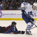 Toronto Maple Leafs left wing James van Riemsdyk, right, skates away from Colorado Avalanche defenseman Nick Holden during the third period of the Avalanche's 4-3 shootout victory in an NHL hockey game in Denver on Thursday, Nov. 6, 2014 The Associated Pr