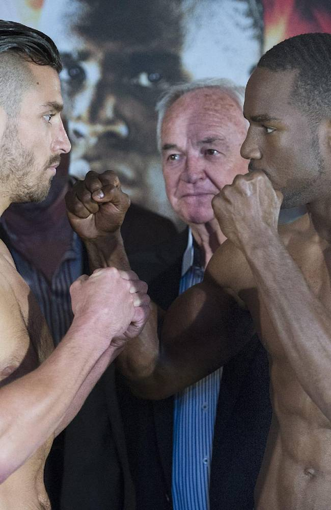 Middleweight boxers David Lemieux, left, and Fernando Guerrero square off during their weigh-in in Montreal, Friday, May 23, 2014, ahead their vacant NABF championship title fight on Saturday