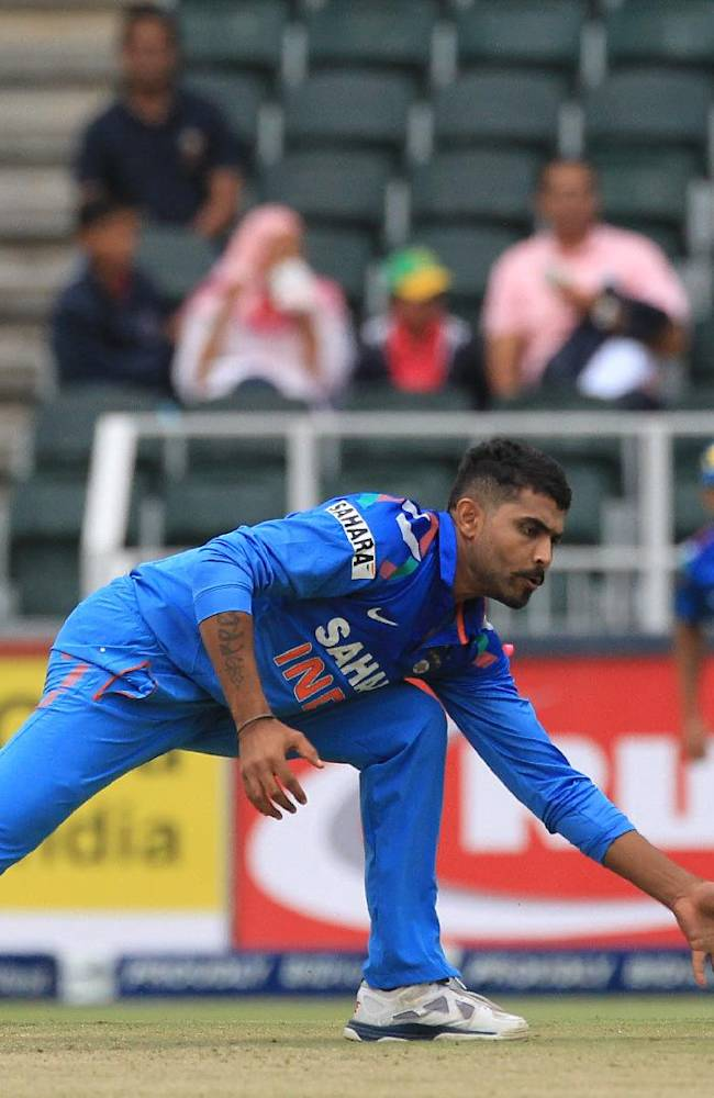 India's Ravindra Jadeja, attempts fielding off own bowling during their 1st One Day International cricket match against South Africa at Wanderers stadium in Johannesburg, South Africa, Thursday, Dec. 5, 2013