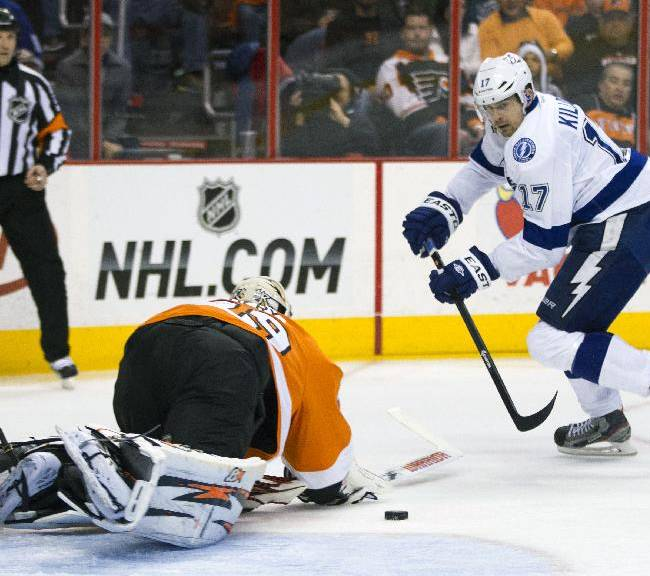 Tampa Bay Lightning's Alex Killorn, right, shot is stopped by Philadelphia Flyers' Ray Emery, left, during the third period of an NHL hockey game, Saturday, Jan. 11, 2014, in Philadelphia. The Lightning won 6-3