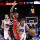 Golden State Warriors' Stephen Curry (30) is defended by Toronto Raptors' Kyle Lowry during the second half of an NBA basketball game on Tuesday, Dec. 3, 2013, in Oakland, Calif. Golden State won 112-103 The Associated Press