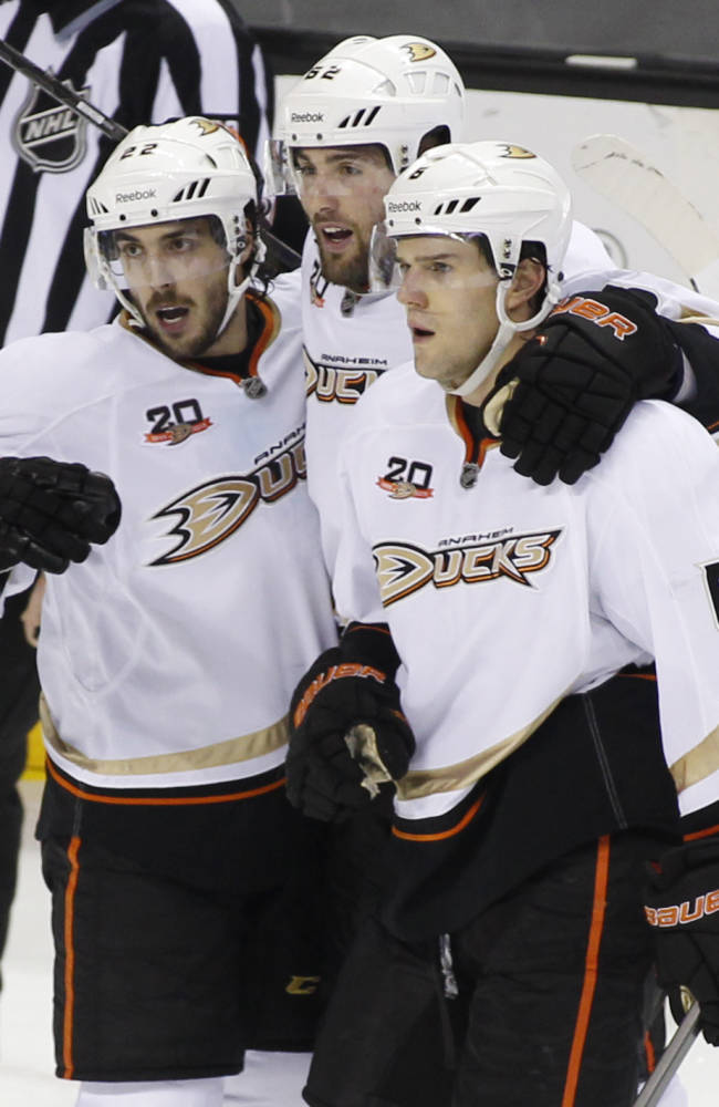 Anaheim Ducks' Patrick Maroon, center, celebrates with teammates Mathieu Perreault, left, and Ben Lovejoy after scoring against the San Jose Sharks during the third period of an NHL hockey game, Sunday, Dec. 29, 2013 in San Jose, Calif