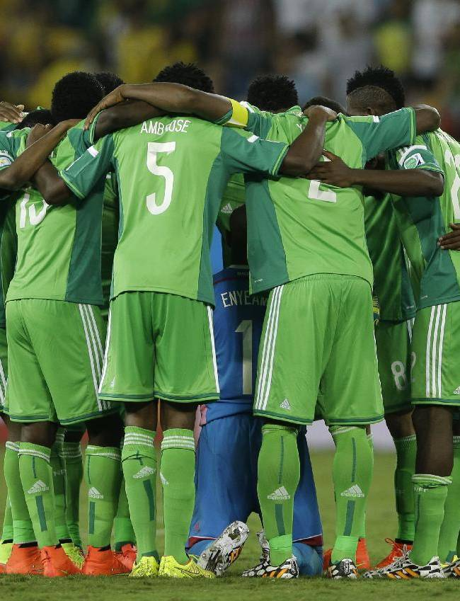 The Nigerian team form a huddle at half time during the group F World Cup soccer match between Nigeria and Bosnia at the Arena Pantanal in Cuiaba, Brazil, Saturday, June 21, 2014