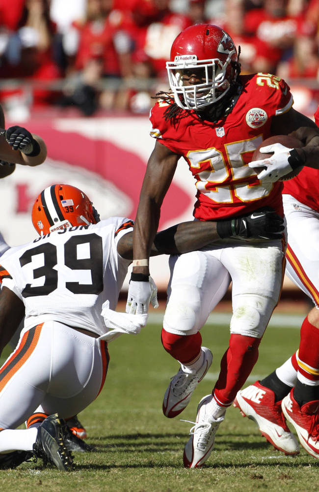 Kansas City Chiefs running back Jamaal Charles (25) breaks a tackle by Cleveland Browns free safety Tashaun Gipson (39) during the second half of an NFL football game in Kansas City, Mo., Sunday, Oct. 27, 2013. The Chiefs defeated the Browns 23-17