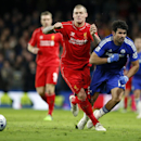 Liverpool's Martin Skrtel, left, battles for the ball with Chelsea's Diego Costa during the English League Cup semifinal second leg soccer match between Chelsea and Liverpool at Stamford Bridge stadium in London, Tuesday, Jan. 27, 2015