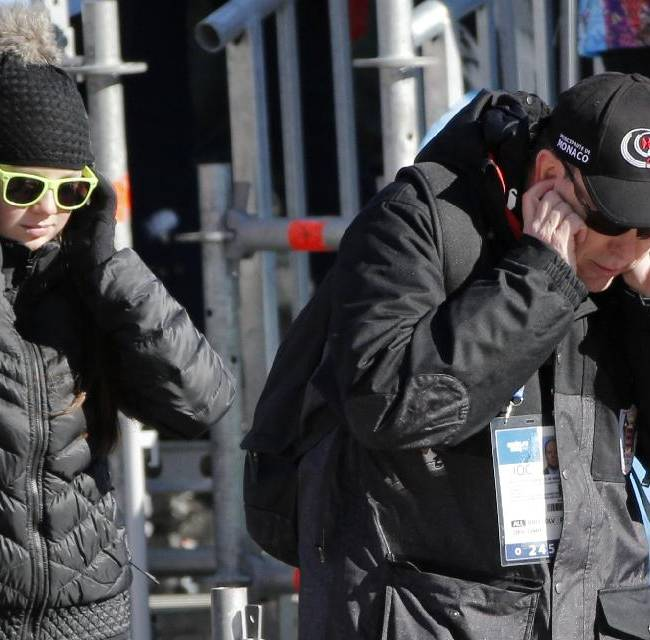 Princess Alexandra of Hanover, left, and Prince Albert of Monaco, right, speak on their mobile phones at the Alpine ski venue during the men's supercombined at the Sochi 2014 Winter Olympics, Friday, Feb. 14, 2014, in Krasnaya Polyana, Russia