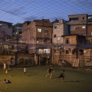 In this June 5, 2013 photo, youths play soccer in the Campo da Lixeira or