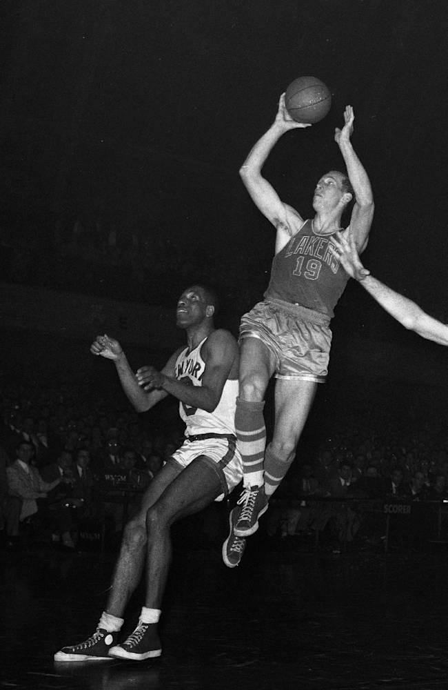 In this April 8, 1953, file photo, Minneapolis Lakers' forward Vern Mikkelsen (19) tries to score in the second period of an NBA basketball game against the New York Knickerbockers at 69th Regiment Armory in New York. Mikkelsen, a Hall of Fame basketball player who won four NBA titles with the Lakers, has died. He was 85. The Lakers say Mikkelsen died Thursday, Nov. 21, 2013