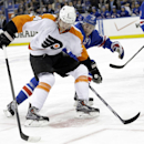 Philadelphia Flyers' Sean Couturier (14) and New York Rangers' John Moore (17) fight for control of the puck during the first period of Game 1 of an NHL hockey first-round playoff series on Thursday, April 17, 2014, in New York The Associated Press