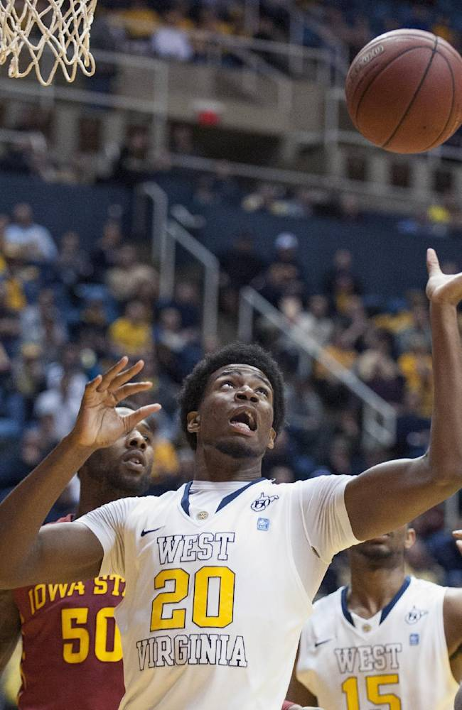 West Virginia's Brandon Watkins (20) goes for a rebound during the first half of an NCAA college basketball game against Iowa State, Monday, Feb. 10, 2014, in Morgantown, W.Va