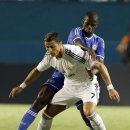 Chelsea midfielder Ramires challenges Real Madrid forward Cristiano Ronaldo (7) during the first half of the International Champions Cup final soccer game, Wednesday, Aug. 7, 2013, in Miami Gardens, Fla. (AP Photo/Wilfredo Lee)