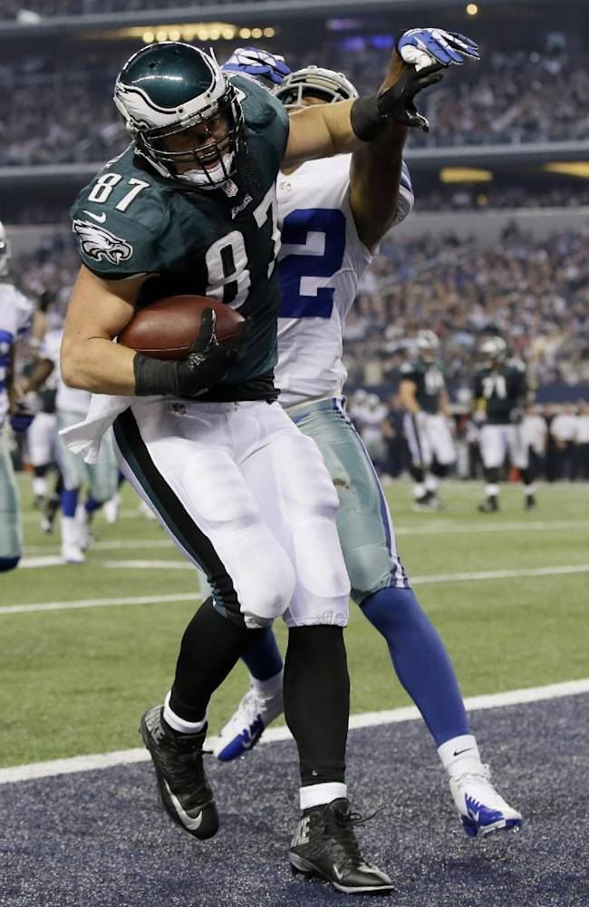 Philadelphia Eagles tight end Brent Celek (87) passes Dallas Cowboys free safety Barry Church (42) to make a touchdown during the first half of an NFL football game, Sunday, Dec. 29, 2013, in Arlington, Texas