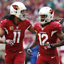 Arizona Cardinals wide receiver Larry Fitzgerald (11) points to the Rams players after a scuffle as he runs to the sidelines with teammate Andre Roberts (12) during the first half of an NFL football game, Sunday, Dec. 8, 2013, in Glendale, Ariz The Associ
