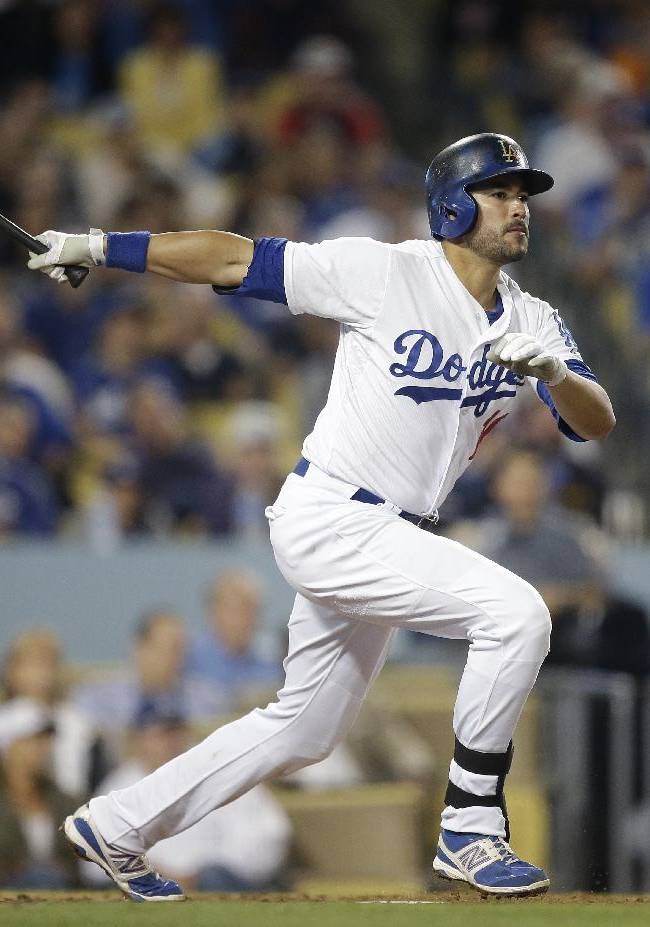 Los Angeles Dodgers' Andre Ethier watches his double to tie the baseball game during the fifth inning against the Arizona Diamondbacks on Tuesday, Sept. 10, 2013, in Los Angeles