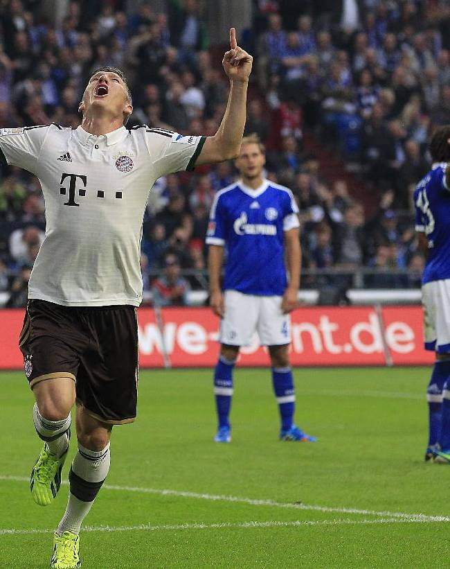 Bayern's Bastian Schweinsteiger celebrates after scoring during the German first division Bundesliga soccer match between Schalke 04 and Bayern Munich in Gelsenkirchen, Germany, Saturday, Sept. 21, 2013