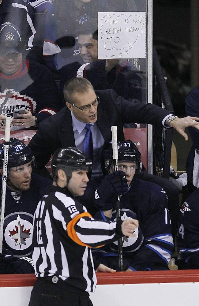 Winnipeg Jets coach Paul Maurice talks to a referee during the third period of an NHL hockey game against the Toronto Maple Leafs on Saturday, Jan. 25, 2014, in Winnipeg, Manitoba. The Jets won 5-4 in overtime