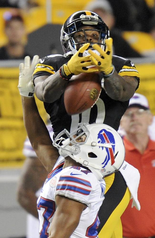 Pittsburgh Steelers wide receiver Martavis Bryant (10), top, cannot come up with the catch over Buffalo Bills defensive back Sam Miller (47) in the fourth quarter of an NFL football preseason game on Saturday, Aug. 16, 2014, in Pittsburgh