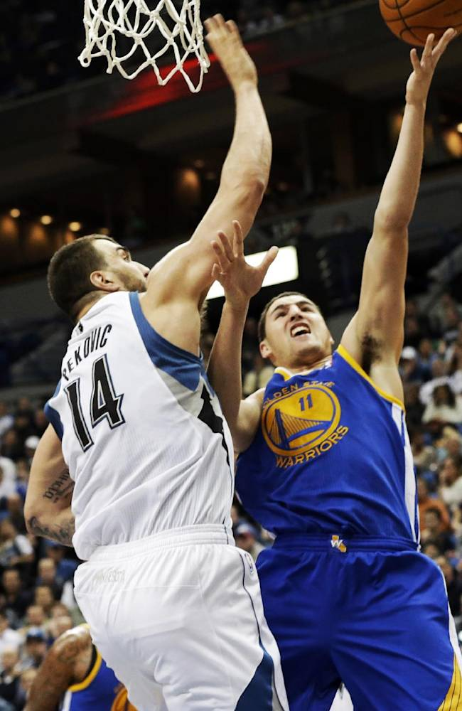 Thompson scores 30 to lead Warriors over Wolves
