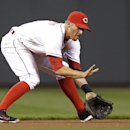 Cincinnati Reds shortstop Zack Cozart fields a ground ball hit by Pittsburgh Pirates' Russell Martin in the first inning of a baseball game, Monday, April 14, 2014, in Cincinnati. Cozart threw Martin out at first The Associated Press