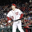 Washington Nationals' Nate McLouth reacts after being hit by a pitch during the eighth inning of a baseball game against the Miami Marlins at Nationals Park Wednesday, April 9, 2014, in Washington. The Nationals won 10-7 The Associated Press