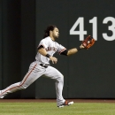 San Francisco Giants' Angel Pagan runs down a fly ball hit by Arizona Diamondbacks' A.J. Pollock during the eighth inning of a baseball game, Wednesday, April 2, 2014, in Phoenix The Associated Press