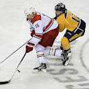Carolina Hurricanes' Tuomo Ruutu (15), of Finland, and Nashville Predators forward Mike Fisher (12) battle for the puck in the first period of an NHL hockey game on Thursday, Dec. 5, 2013, in Nashville, Tenn The Associated Press