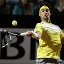 Italy's Fabio Fognini returns the ball to Spain's Rafael Nadal during their match at the Italian Open tennis tournament in Rome, Wednesday, May 15, 2013. (AP Photo/Andrew Medichini)