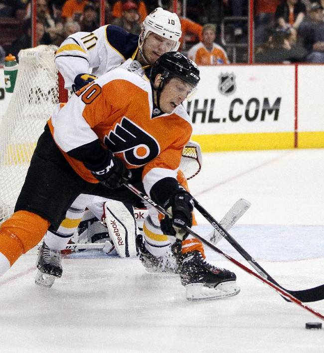 Philadelphia Flyers' Vincent Lecavalier, front, vies for controls of the puck with Buffalo Sabres' Christian Ehrhoff during the second period of an NHL hockey game, Sunday, April 6, 2014, in Philadelphia. The Flyers won 5-2