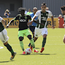 Seattle Sounders player Obafemi Martins, second from left, vies for the ball against Portland Timbers Norberto Paparatto, second from right, during an MLS soccer match in Portland, Ore., Sunday, Aug. 24, 2014. The Sounders won the game 4 to 1 The Associa