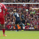 Southampton's Nathaniel Clyne, center right, celebrates after scoring against Liverpool during their English Premier League soccer match at Anfield Stadium, Liverpool, England, Sunday Aug. 17, 2014