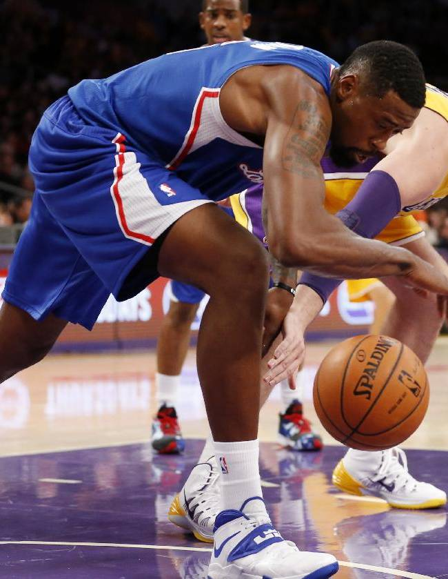 Los Angeles Clippers DeAndre Jordan, left, grabs the ball in front of Los Angeles Lakers Pau Gasol, of Spain, during the first half of an NBA basketball game in Los Angeles, Tuesday, Oct. 29, 2013