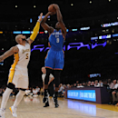 LOS ANGELES, CA - MARCH 1: Serge Ibaka #9 of the Oklahoma City Thunder shoots against Carlos Boozer #5 of the Los Angeles Lakers on March 1, 2015 at Staples Center in Los Angeles, California. (Photo by Juan Ocampo/NBAE via Getty Images)