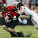 Boston College linebacker Tim Joy (33) tackles Maryland quarterback Caleb Rowe (7) on a carry in the fourth quarter of an NCAA college football game in Boston, Saturday, Oct. 27, 2012. Boston College won 20-17. (AP Photo/Michael Dwyer)