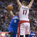 Philadelphia 76ers guard James Anderson (9) loses control of the ball as Toronto Raptors center Jonas Valanciunas (17) defends during second half NBA action in Toronto on Wednesday, April 9, 2014 The Associated Press